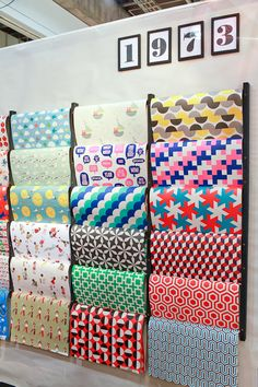 NYIGF Winter 2013 Exhibitors via Oh So Beautiful Paper (168) Shop Interior Design, Store Design, Fabric Display, Scarf Display, Fabric Design, Pattern Design, Space Fabric, Stationary Store, Store Window Displays
