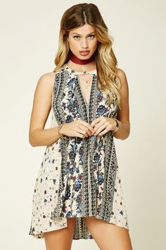 A woven trapeze dress featuring an ornate floral print, sleeveless cut, buttoned round neckline with a triangle cutout, and dual on-seam slip pockets. This is an independent brand and not a Forever 21 branded item.