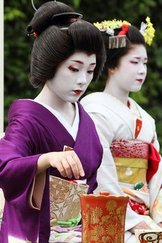 Japanese Tea Ceremony by Teruhide Tomori. Traditional tea ceremony presented by Kamishichiken Maiko & Geiko ladies in the garden of Kamigamo shrine, a Shinto sanctuary on the banks of the Kamo River in north Kyoto, Japan.