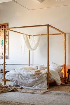 Urban Outfitters Eva Wooden Canopy Bed