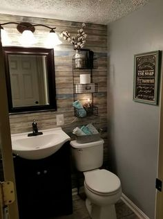 Boring bathroom update using shiplap style wall paper.