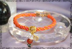 Golden OM Sacral Chakra Kumihimo Bracelet by LaHermosaBruja