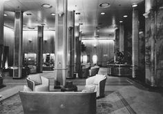 The First Class Promenade Square of the Queen Elizabeth of 1939, consort flagship of the Cunard-White Star Line. Photographed following post-War restoration to passenger service. 1946. Image courtesy the private collection of John Cunard-Shutter.