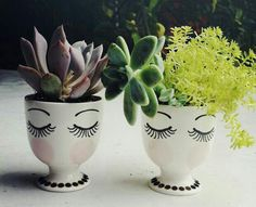 I would love to make some of these with cheap planters and paint :)