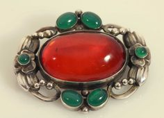 Georg Jensen sterling brooch no. 78 with amber and green agate. This brooch was designed by Georg Jensen.