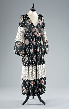 Brocaded gauze summer dress, early 1970s, by Thea Porter. The dress features black and red diamond medallions, the skirt and sleeves applied with deep lace flounces.