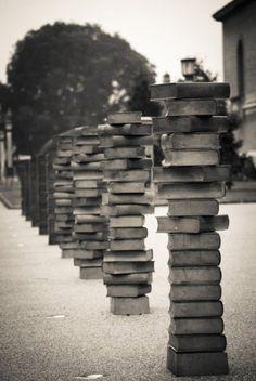 Pillars of books outside Cambridge Library.