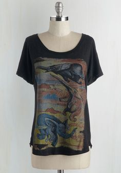 Impossibly Cool Top. Imagine sporting the artfully illustrated flying elephants on this graphic tee - the warm reds, blues, and yellows of this pretty picture beaming against this ultra-soft charcoal-grey knit. #multi #modcloth
