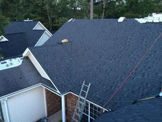 The cool color of Appalachian Sky, with its subtle variety of dark grays and black, brings appealing definition to homes with brick and stone facades, as shown here. www.myrtle-beach-roofing.com Surfside Beach, Murrells Inlet, Stone Facade, Pawleys Island, Little River, Myrtle Beach Sc, Brick And Stone, House Projects, Facades