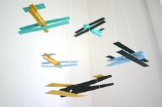 Make a simple airplane mobile for baby with clothespins and paint. Click here to see how.