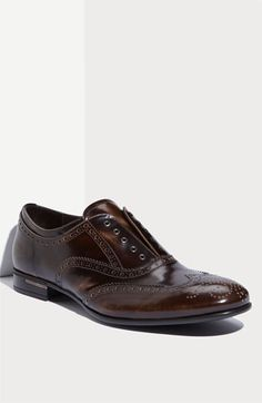 Prada Laceless Wingtip Oxford   Be the first to write a review  | ask a question  Glossy coating lacquers a distressed-leather wingtip cut for a laceless look.  Leather upper and lining/synthetic sole.  Made in Italy.  Men's
