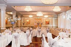 Down Hall Country House Hotel Wedding Reception Room Decorated With Cherry Blossom In Tall Vases