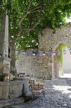 Provence, France  On a lazy afternoon with a beautiful glass of wine, cheese, baguette, and fruit (if it only thoughts could transport me)