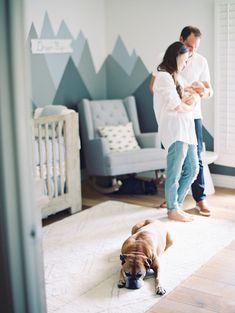 newborn lifestyle portraits in a modern gray and blue nursery