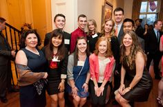 A group distinguished NU juniors and seniors were invited to a reception at the home of Mr. and Mrs. Auon as part of the Huntington 100