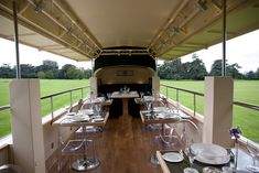The dining area on the top deck can seat 18 in dark green leather banquettes and Louis Ghost chairs.