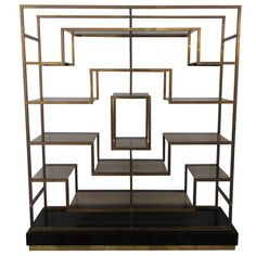 monumental geometric brass shelving by Romeo Rega, Italy, 1970's | From a unique collection of antique and modern shelves at https://www.1stdibs.com/furniture/storage-case-pieces/shelves/