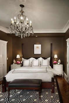 Dark brown walls, white trim, dark furniture and light bedding.  Love the sharp contrast