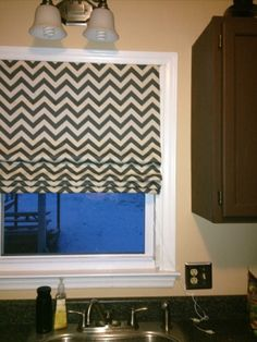 DIY roman shade. This might be my next Pinterest project.
