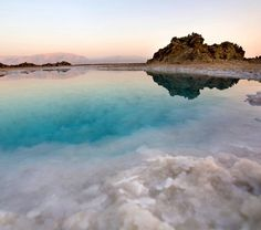 Technically, you can't swim in the Dead Sea, one of the saltiest bodies of water on earth, which is bordered by Israel and Jordan; Swimming in it is more like floating. The salt lake has attracted visitors for thousands of years, and the salt and minerals offer many healthy and beauty benefits, as well as cause its milky blue-green color.  via @mydomaine