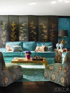In the ground-floor sitting room of a London townhouse designed by Philip Vergeylen, the slipper chairs, upholstered in a cotton velvet by Lewis & Wood, and the sofa are by Nicholas Haslam Ltd., the ikat pillows are from Istanbul, and the 19th-century Korean screen was bought at Christie's; the table covering is in a linen by Jim Thompson, and the rug is by the Rug Company.   - ELLEDecor.com