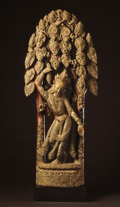 Chintamani Lokeshvara. Wood with paint, Nepal, ca. 16th century, LACMA, Salabanjika, śālabañjika meaning 'breaking a branch of a sala tree', The salabhanjika concept stems from ancient symbolism linking a chaste maiden with the sala tree or the asoka tree through the ritual called dohada, or the fertilisation of plants through contact with a young woman.