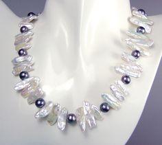 white biwa and black pearl necklace