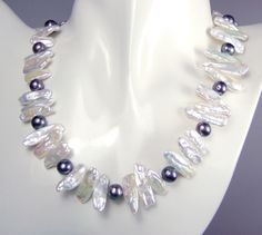 white biwa and black pearl necklace