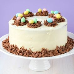 Carrot cake with creamy white chocolate frosting and milk chocolate eggs for Easter!