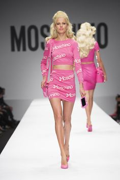 barbie girl inspired moschino milan fashion week show models came with matching accessories such as the moschino suitcase and hanger shaped