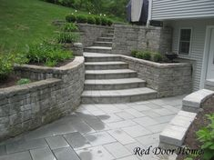 basement entrance staircase with concrete pavers retaining wall blockd