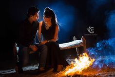 Bonfire pre-wedding ideas are great for night couple portrait for wedding or pre-wedding shoot. We had this beautiful bonfire done in the village with couple all dressed up in party wear of black color which made them become part of the image beautifully. The flash from background gave nice blue color to contrast the bonfire of yellow-orange color of front.