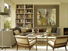 This Douglas Durkin Design Interiors room shows how a perfect painting (subject, color AND composition) can balance a bookcase. The dark painted wall for that area was a necessary element to create a unified feeling.  Barbara Wirth Art loves this interesting room setting!