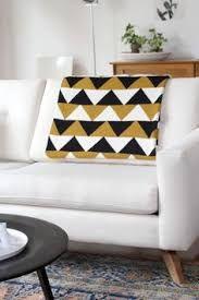 Image result for triangle design linen lumbar cushion metallic triangle
