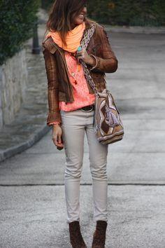 That's one killer leather jacket. Cute leopard print boots too! Via Mytenida.