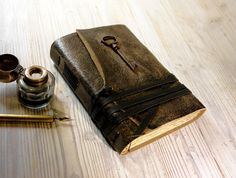 Unspoken - Leather Journal with Antique Skeleton Key and Vintage Style Pages by MedievalJourney on Etsy