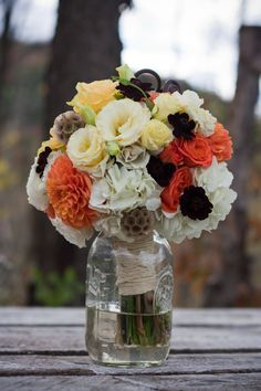 Rustic country wedding guide to make a perfect rustic wedding chic. Look through real rustic weddings, get ideas and inspiration, ask questions or find the perfect country wedding venue to host your rustic country wedding. Orange Wedding Flowers, Rustic Wedding Flowers, Wedding Flower Arrangements, Wedding Colors, Fall Flowers, Country Wedding Bouquets, Flower Bouquet Wedding, Bridal Bouquets, Rustic Bouquet