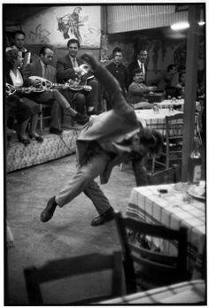 Henri Cartier-Bresson - Zeibekiko dancer in a café. Piraeus, Greece. 1953.