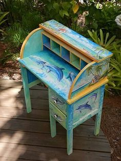 Great idea. Commission an artist to paint her desk. Maybe more.