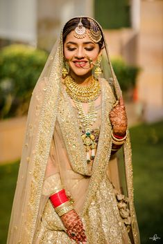 A gorgeous golden bridal look - that stunning aari work monotone Lehenga looks fab paired with a gold and Kundan jewellery as a light yet Royal look topped with a Pearl passa. How pretty does the contrasting red chura look against that gold shimmer Lehenga (C) Sam & Ekta #intimatewedding #wittyvows #weddingideas #bridalhair #brideandgroomphotos #indianweddinginspiration #bridalmakeup #bridaljewellery #bridallengha #bridaloutfit Bridal Dupatta, Anarkali Lehenga, Bridal Makeup Looks, Bridal Looks, Drape Sarees, Other Outfits, Traditional Looks, Saree Styles, Indian Bridal