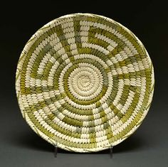 """Coiled basket in beargrass and yucca (Tohono O'odham) The Tohono O'odham, which means """"Desert People"""", were formerly known as the Papago by the Spanish and are descendants of the Hohokam culture, which flourished between 200- 1450 AD in what is now southern and central Arizona."""