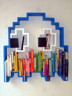 "3d-pac-man-ghost-shaped-shelf   All of our pieces are built specially for you. Choose the size, the color, even the direction where the ghost is peeping!!   100% customizable!  100% Made In Barcelona (Spain)!  It takes us between 4-6 weeks to make and deliver your very own pac-man shelf!  Standard Dimensions: 76 x 71 x 10cm (30"" x 28"" x 4"")."