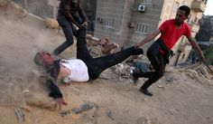 24 hours: Egyptian protesters drag a wounded Muslim Brotherhood supporter
