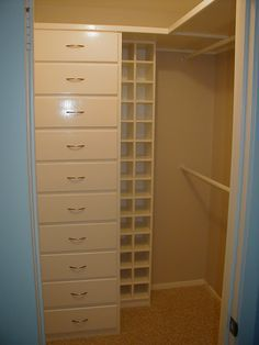 master closet idea..Built Ins are always smart and check out the SHOW RACK that is built in!!  Great!!