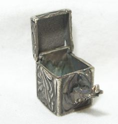 """VINTAGE STERLING SILVER 925 ETCHED PRAYER WISH BOX CHARM PENDANT JEWELRY RARE    Seller information  justinsublime (1939  )    99.9%Positive feedback  Save this seller  See other items     AdChoice  Item condition:Pre-owned  """"LATCH NEEDS REPAIR OR TIGHTENING""""  Time left: 6d 22h (Jun 27, 2013 17:11:35 PDT)  Starting bid:US $7.77  [0 bids ]"""