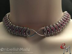 BDSM / Gorean Slave Collar: Poor Kings chainmaille choker/necklace using anodized aluminum rings with a lobster claw clasp and front Infinity Symbol. Plenty of sizes available to fit perfectly! For best fitting results, please measure your neck and add 1/2.  For your made to order choker, indicate your color choice and desired length when ordering. Please note, color shade may vary slightly from picture shown.  **FREE SHIPPING WITHIN THE US WITH TRACKING!** Normal turnaround is within 3…
