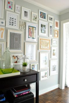 i like seeing a gallery wall with some color (not just b) (young house love) - such a great blog with cute ideas!