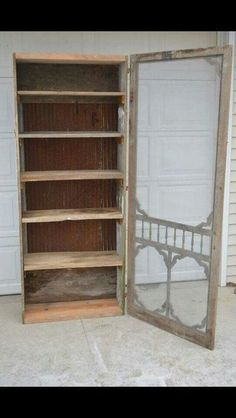 Old screen door attached to a shelf. Cool display More