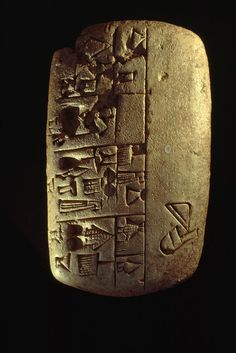 ✮ Cuneiform writing describes commodities on a Mesopotamian clay tablet.