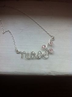 I have this necklace and wear it ALL the time!  It's classy and cute!  Proud to be a nurse!  #nursenecklace  #nurse #nursiness #nursing #registerednurse